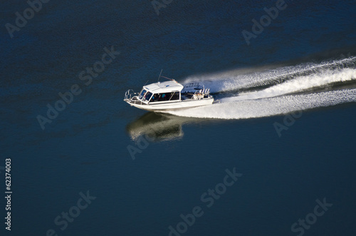 Pleasure Boat Moving Down River