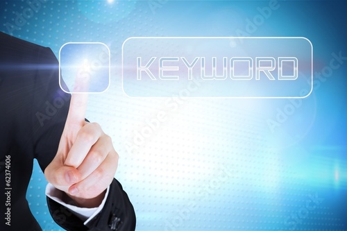Businesswomans finger touching Keyword button