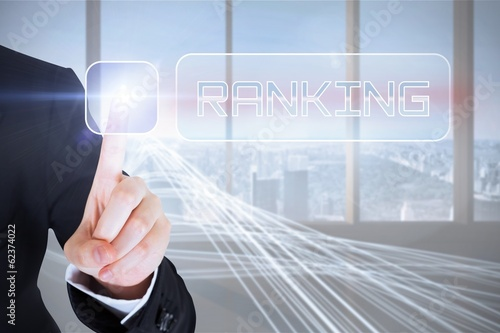 Businesswomans finger touching Ranking button