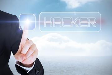 Businesswomans finger touching Hacker button