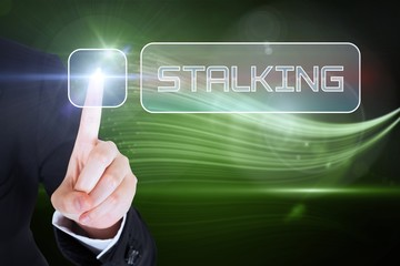 Businesswomans finger touching Stalking button