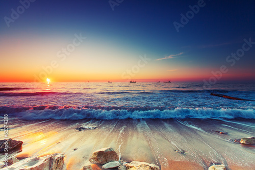 canvas print picture Sunrise over sea