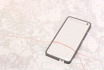 Smartphone gps app on paper map background.