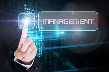 Businesswomans finger touching Management button
