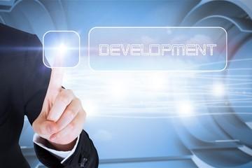 Businesswomans finger touching Development button