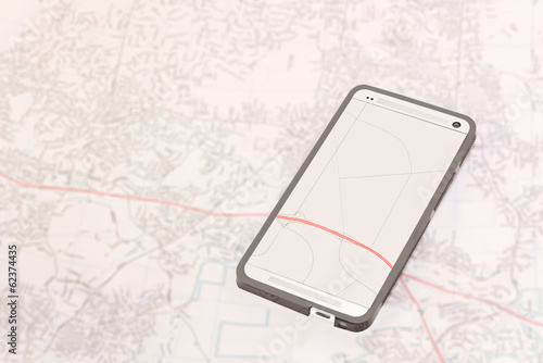 Smartphone gps app on paper map background. - 62374435