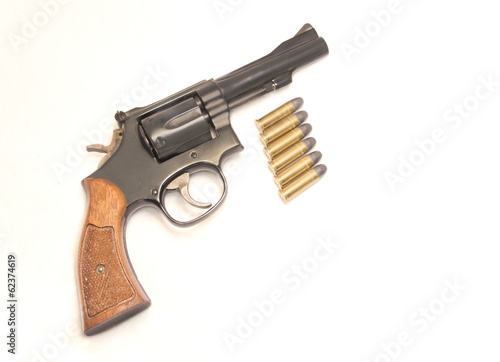 Classic six shooter gun with bullets,isolated on white