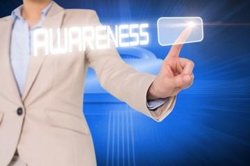 Businesswomans finger touching awareness button