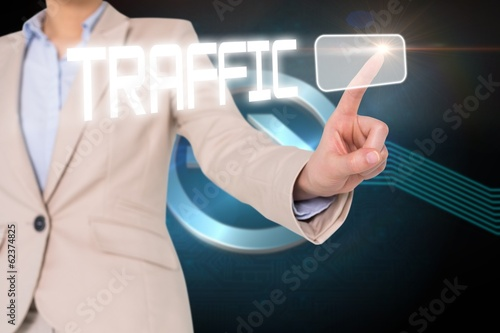 Businesswomans finger touching traffic button