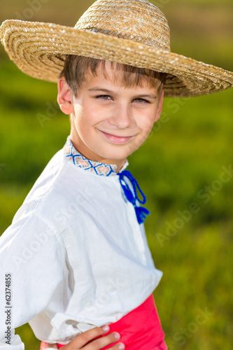 Cute child in traditional Ukrainian clothes outdoor