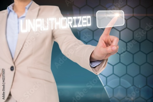 Businesswomans finger touching unauthorizec button