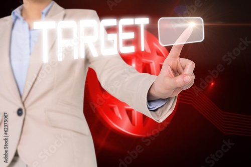 Businesswomans finger touching target button
