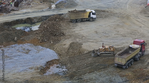 time lapse construction vehicle dumping rock