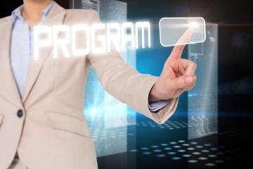 Businesswomans finger touching program button