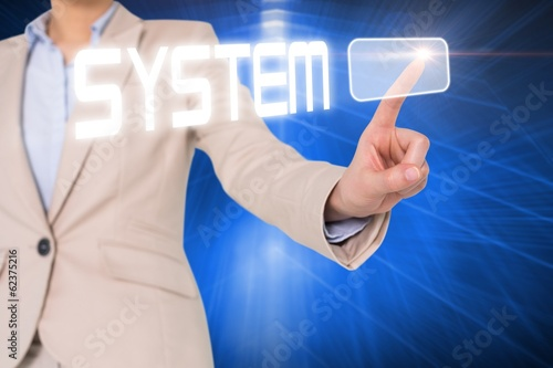 Businesswomans finger touching system button
