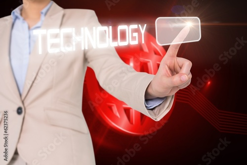 Businesswomans finger touching technology button