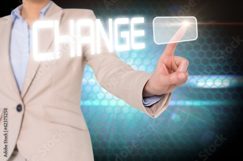 Businesswomans finger touching change button