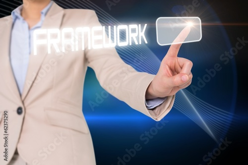 Businesswomans finger touching framework button