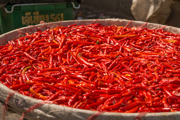 small, red, very  spicy chilli peppers on an asian market.