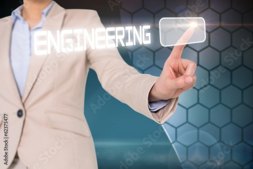 Businesswomans finger touching engineering button
