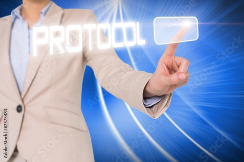 Businesswomans finger touching protocol button