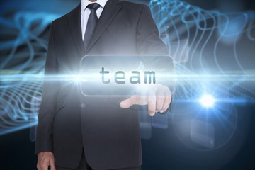 Team against abstract glowing black background