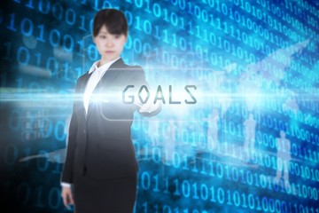 Goals against shiny blue binary code on black background