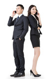 Asian business man and woman take a call
