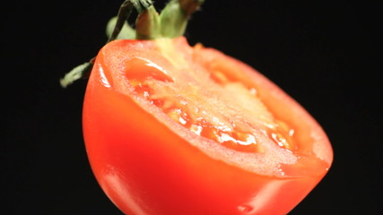 Tomato rotating with water drops. Find similar in our portfolio