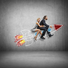 Businessman and young woman flying with rocket