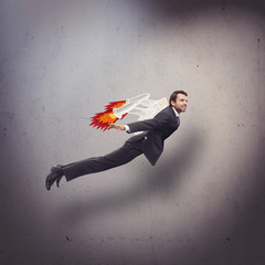 Businessman flying with rocket backpack