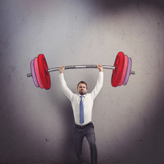 Businessman lifting barbell