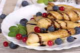 pancakes with berries currants and blueberries with chocolate sa