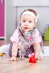 Adorable baby girl playing