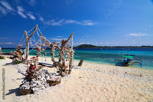 Traditional boat on tropical beach