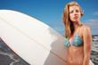 Beautiful Young Woman Surfer Girl in Bikini with Surfboard at a