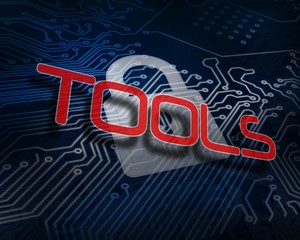 Tools against white digital padlock over circuit board