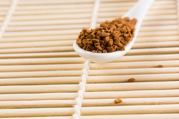 white spoon with coffee granules