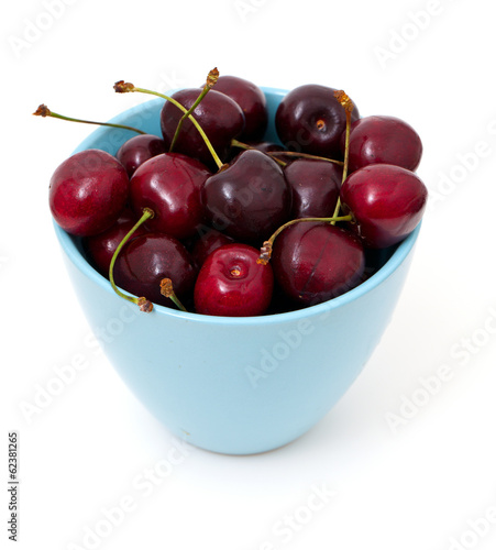cherries in a blue cup