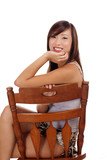 Teen Asian Girl Sitting On Chair Smiling