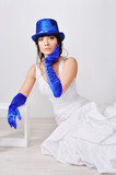 Frightened, surprised the bride in blue gloves and hat