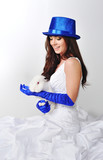Bride with a rabbit in a blue hat and blue gloves