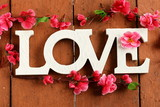 "word ""love""  made ​​of wooden letters on vintage background"