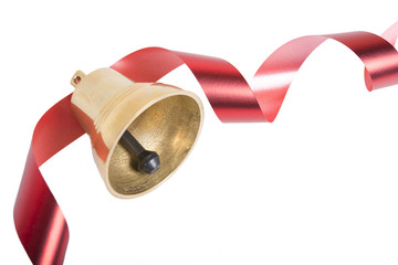 Christmas bell with red ribbon isolated on white background