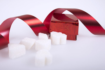Gift, sugar cubes with red ribbon.