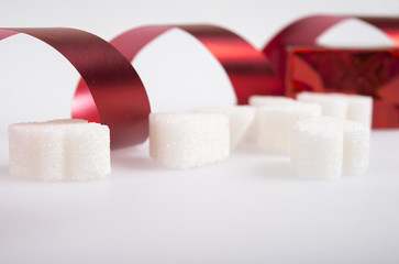 sugar cubes with red ribbon.