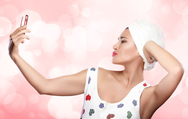 Beautiful Woman with Towel on Head Making Selfie. Self-Portrait