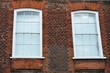 Two windows in red brick