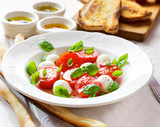 Caprese salad, cherry tomato, mozzarella and basil