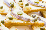 Canapes with anchovy and capers